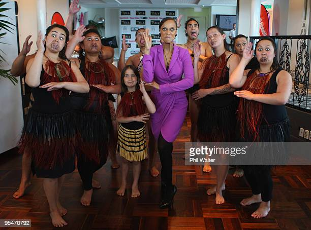 Tyra Banks strikes a pose with a traditional maori cultural group during the Tyra Banks Global BIO Summit at The Wharf on December 16 2009 in...