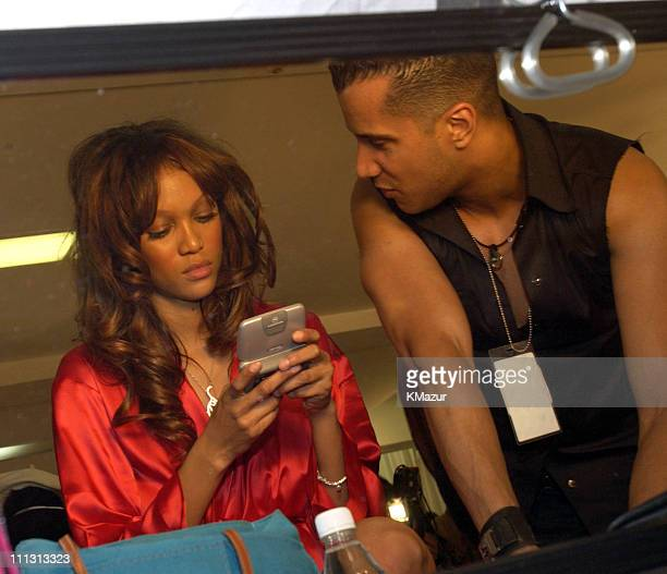 Tyra Banks uses her Motorola twoway pager during 8th Annual Victoria's Secret Fashion Show Hair and Makeup at The New York State Armory in New York...