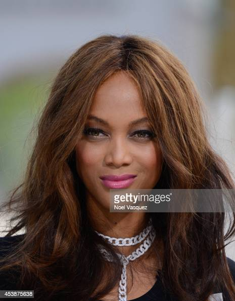 Tyra Banks visits 'Extra' at Universal Studios Hollywood on August 20 2014 in Universal City California