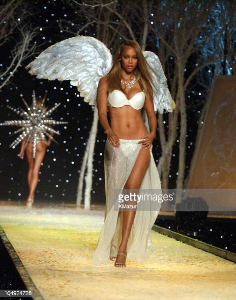 Tyra Banks wearing embellished Victoria's Secret body bare lightly lined demi embellished Victoria's Secret body bare satin thong and embellished...