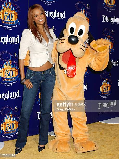 Tyra Banks with Pluto at the Disneyland in Anaheim California