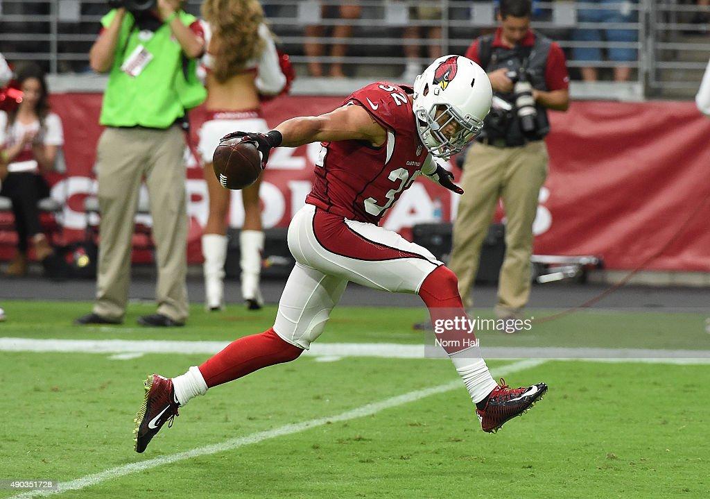 Tyrann Mathieu of the Arizona Cardinals celebrates after making an interception against the San Francisco 49ers at University of Phoenix Stadium on...