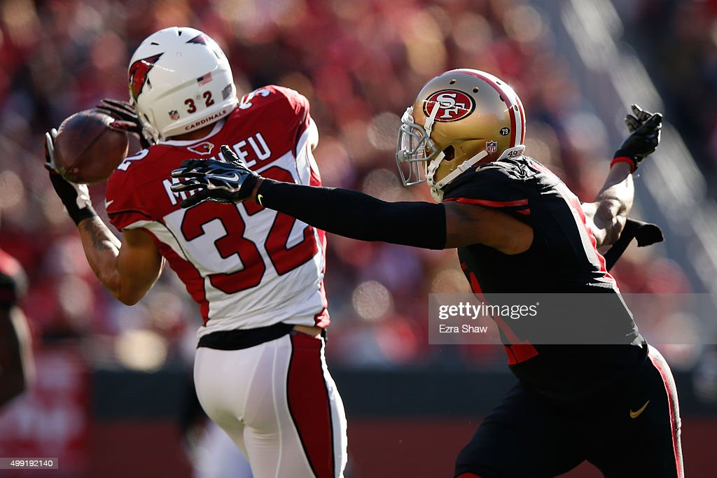 Tyrann Mathieu of the Arizona Cardinals intercepts a pass intended for Quinton Patton of the San Francisco 49ers during their NFL game at Levi's...