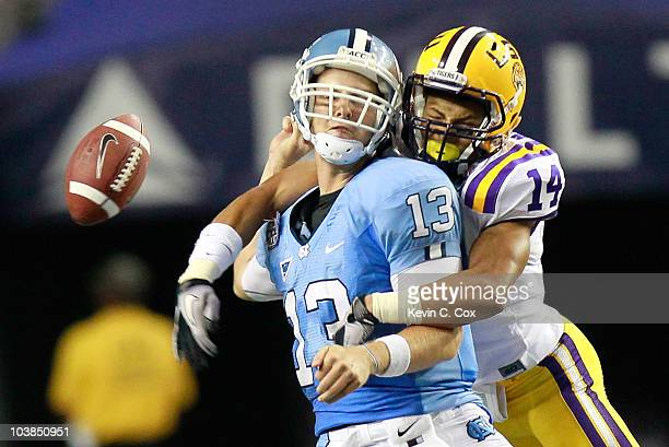 Tyrann Mathieu of the LSU Tigers forces a fumble by quarterback TJ Yates of the North Carolina Tar Heels during the ChickfilA Kickoff Game at Georgia...