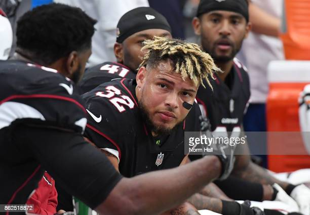 Tyranne Mathieu of the Arizona Cardinals talks with teammates while sitting on the bench during the second half against the Tampa Bay Buccaneers at...