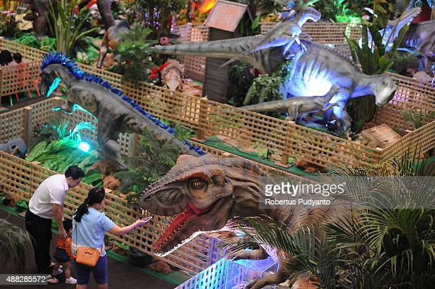 Tyrannosaurus replica is displayed in the Dinosaur Adventure and Learning Experience Park at Tunjungan Plaza on September 15 2015 in Surabaya...