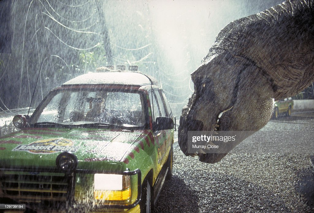 A Tyrannosaurus Rex menaces the theme park's first customers in a scene from the film 'Jurassic Park', 1993.