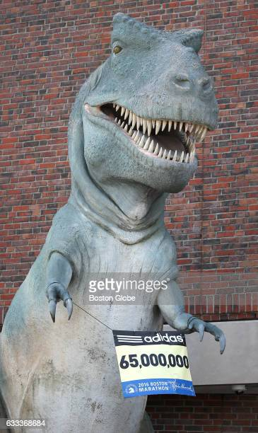 Tyrannosaurus statue in front of the Museum of Science in Boston holds up a Boston Marathon sign on Apr 18 2016