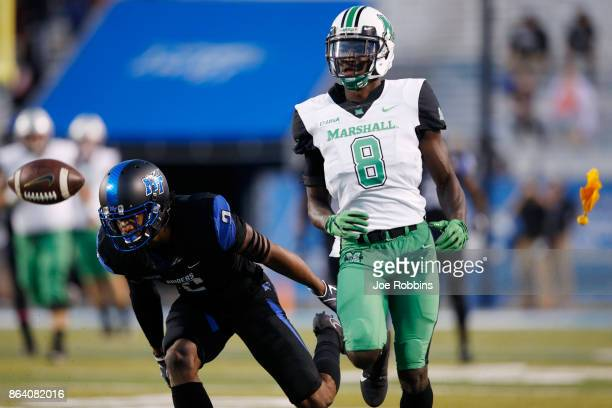 Tyre Brady of the Marshall Thundering Herd draws a pass interference penalty from Charvarius Ward of the Middle Tennessee Blue Raiders in the first...
