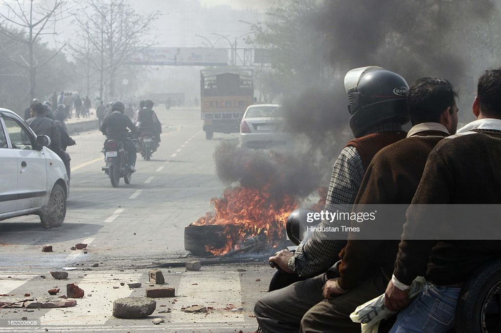 Tyre burned by mob to restrict the traffic during 48 hours nationwide strike called by eleven major Trade Unions to protest Government's economic and labour policies on February 20, 2013 in Noida, India.