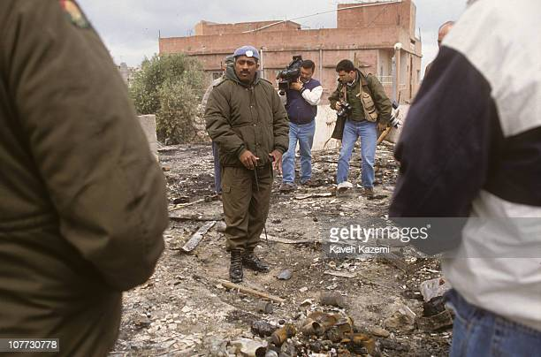 UN peacekeepers stand on the site of the UN camp in Qana during a visit by the press corps where Israeli missile was fired on during Operation Grapes...