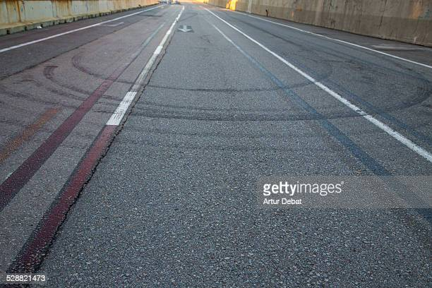 Tyre skid-marks on road in the Barcelona harbor