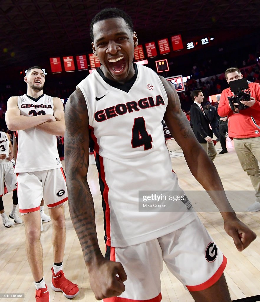 Tyree Crump #4 of the Georgia Bulldogs celebrates as he walks off the floor following a victory over the Florida Gators at Stegeman Coliseum on January 30, 2018 in Athens, Georgia.