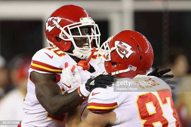 Tyreek Hill of the Kansas City Chiefs celebrates with Travis Kelce after scoring a touchdown during the third quarter against the New England...