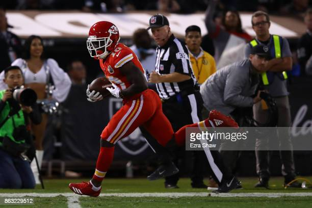 Tyreek Hill of the Kansas City Chiefs runs for a 64yard touchdown against the Oakland Raiders during their NFL game at OaklandAlameda County Coliseum...
