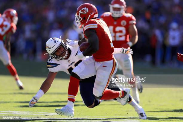Tyreek Hill of the Kansas City Chiefs runs past James Onwualu of the Los Angeles Chargers during the second half of a game at StubHub Center on...