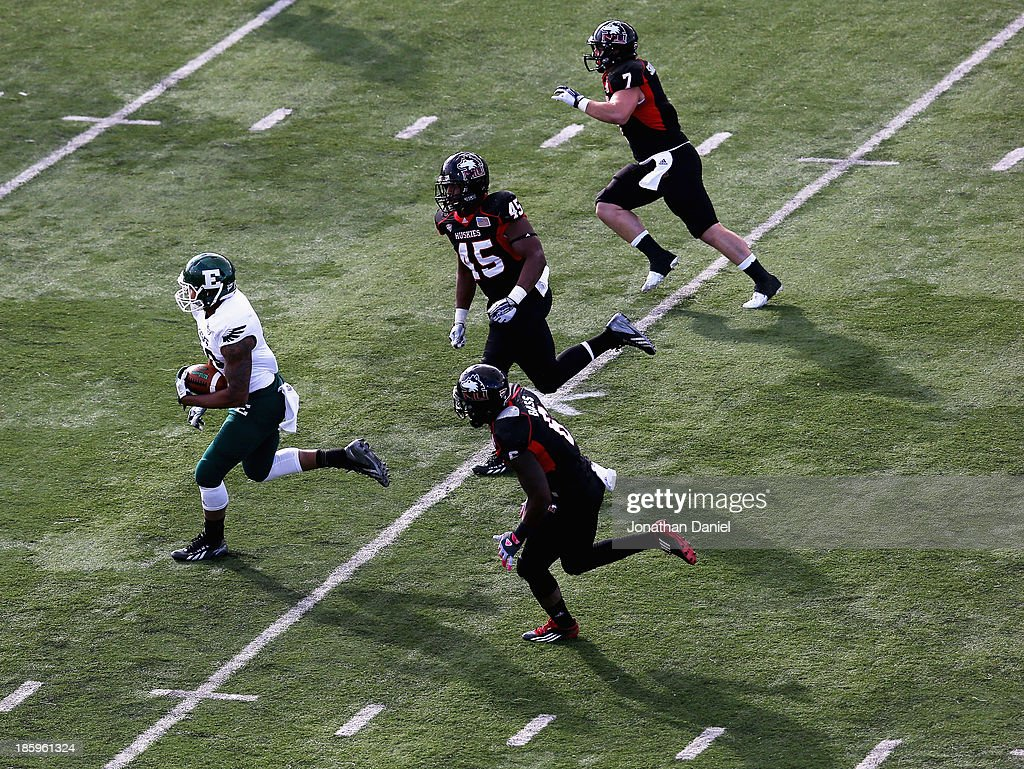 Tyreese Russell #88 of the Eastern Michigan Eagles is chased by (top to bottom) Michael Santacaterina #7, Boomer Mays #45 and Jamaal Bass #6 of the Northern Illinois Huskies at Brigham Field on October 26, 2013 in DeKalb, Illinois.
