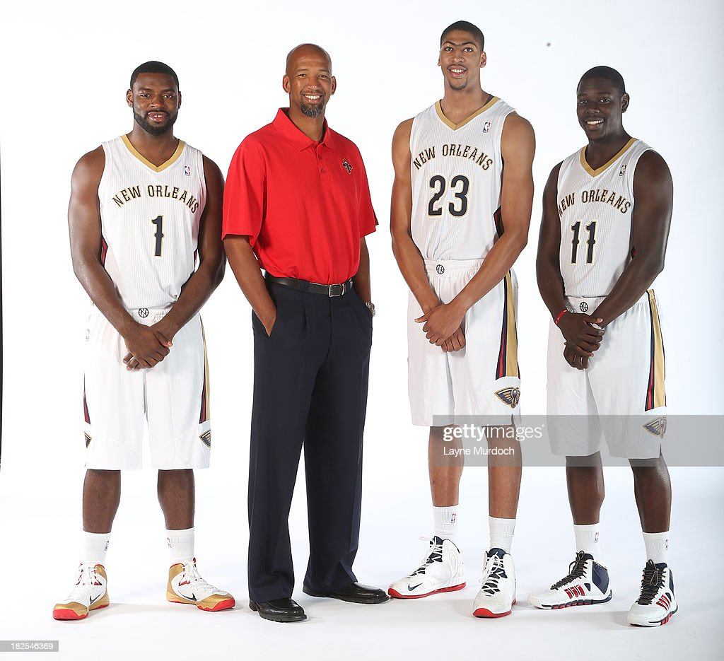 <a gi-track='captionPersonalityLinkClicked' href=/galleries/search?phrase=Tyreke+Evans&family=editorial&specificpeople=4851025 ng-click='$event.stopPropagation()'>Tyreke Evans</a>, #1 Head Coach <a gi-track='captionPersonalityLinkClicked' href=/galleries/search?phrase=Monty+Williams&family=editorial&specificpeople=220489 ng-click='$event.stopPropagation()'>Monty Williams</a>, Anthony Davis #23 and Jrue Holida #11 of The New Orleans Pelicans pose for photos during NBA Media Day on September 30, 2013 at the New Orleans Pelicans practice facility in Metairie, Louisiana.