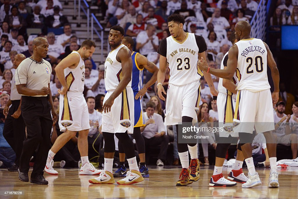 Tyreke Evans Anthony Davis and Quincy Pondexter of the New Orleans Pelicans walk on the court against the Golden State Warriors in Game Four of the...