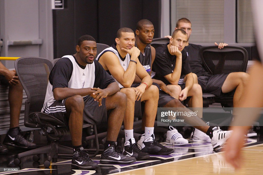 Tyreke Evans Francisco Garcia Desmond Mason Sergio Rodriguez and Spencer Hawes of the Sacramento Kings watch the action during training camp on...