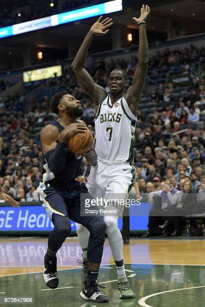 Tyreke Evans of the Memphis Grizzlies drives to the basket against Thon Maker of the Milwaukee Bucks during the second half of a game at the Bradley...