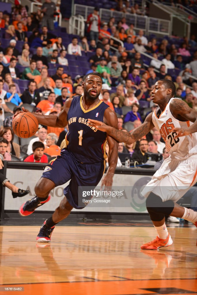<a gi-track='captionPersonalityLinkClicked' href=/galleries/search?phrase=Tyreke+Evans&family=editorial&specificpeople=4851025 ng-click='$event.stopPropagation()'>Tyreke Evans</a> #1 of the New Orleans Pelicans drives against <a gi-track='captionPersonalityLinkClicked' href=/galleries/search?phrase=Archie+Goodwin&family=editorial&specificpeople=9086088 ng-click='$event.stopPropagation()'>Archie Goodwin</a> #20 of the Phoenix Suns on November 10, 2013 at U.S. Airways Center in Phoenix, Arizona.