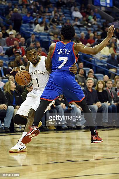 Tyreke Evans of the New Orleans Pelicans drives around Larry Drew II of the Philadelphia 76ers during the first half of a game at the Smoothie King...