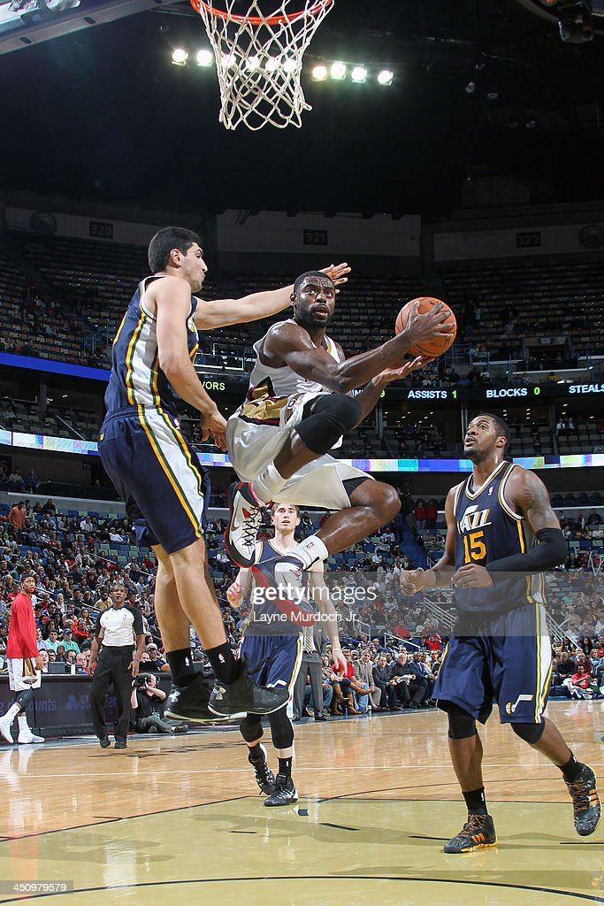<a gi-track='captionPersonalityLinkClicked' href=/galleries/search?phrase=Tyreke+Evans&family=editorial&specificpeople=4851025 ng-click='$event.stopPropagation()'>Tyreke Evans</a> #1 of the New Orleans Pelicans drives to the basket against <a gi-track='captionPersonalityLinkClicked' href=/galleries/search?phrase=Enes+Kanter&family=editorial&specificpeople=5621416 ng-click='$event.stopPropagation()'>Enes Kanter</a> #0 of the Utah Jazz on November 20, 2013 at the New Orleans Arena in New Orleans, Louisiana.
