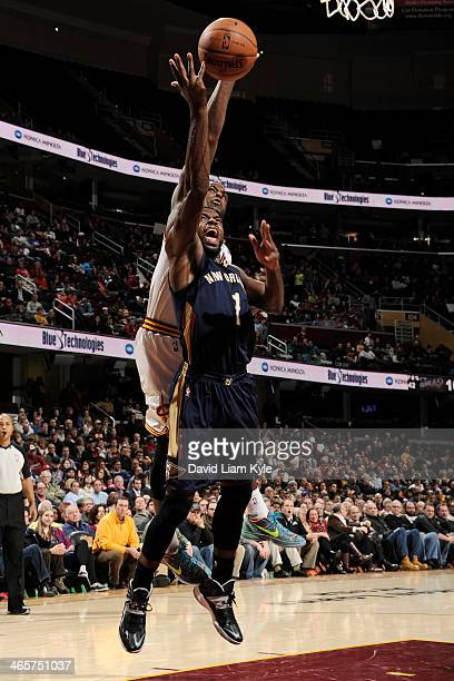Tyreke Evans of the New Orleans Pelicans drives to the basket against Dion Waiters of the Cleveland Cavaliers at The Quicken Loans Arena on January...