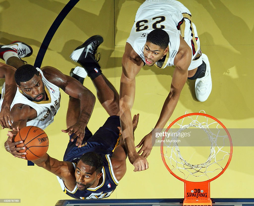 <a gi-track='captionPersonalityLinkClicked' href=/galleries/search?phrase=Tyreke+Evans&family=editorial&specificpeople=4851025 ng-click='$event.stopPropagation()'>Tyreke Evans</a> #1 of the New Orleans Pelicans fights for the rebound against Mike Harris #33 of the Utah Jazz on November 20, 2013 at the New Orleans Arena in New Orleans, Louisiana.