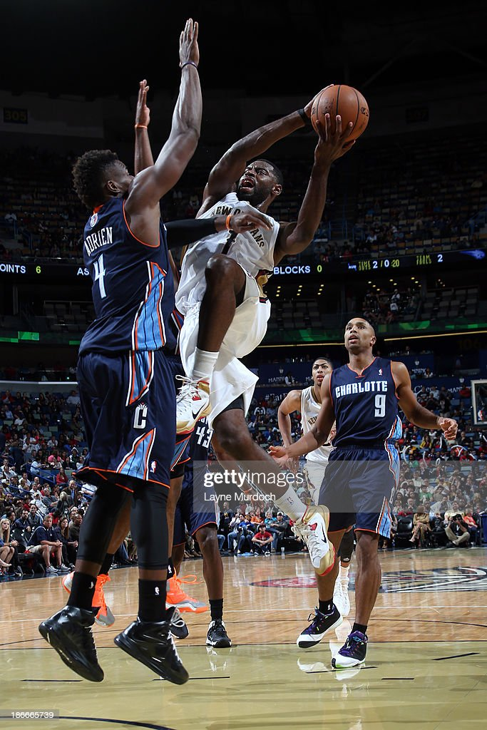 <a gi-track='captionPersonalityLinkClicked' href=/galleries/search?phrase=Tyreke+Evans&family=editorial&specificpeople=4851025 ng-click='$event.stopPropagation()'>Tyreke Evans</a> #1 of the New Orleans Pelicans goes to the basket against <a gi-track='captionPersonalityLinkClicked' href=/galleries/search?phrase=Jeff+Adrien&family=editorial&specificpeople=727235 ng-click='$event.stopPropagation()'>Jeff Adrien</a> #4 of the Charlotte Bobcats on November 2, 2013 at the New Orleans Arena in New Orleans, Louisiana.