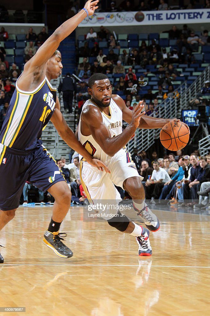 <a gi-track='captionPersonalityLinkClicked' href=/galleries/search?phrase=Tyreke+Evans&family=editorial&specificpeople=4851025 ng-click='$event.stopPropagation()'>Tyreke Evans</a> #1 of the New Orleans Pelicans handles the ball against <a gi-track='captionPersonalityLinkClicked' href=/galleries/search?phrase=Alec+Burks&family=editorial&specificpeople=6834208 ng-click='$event.stopPropagation()'>Alec Burks</a> #10 of the Utah Jazz on November 20, 2013 at the New Orleans Arena in New Orleans, Louisiana.