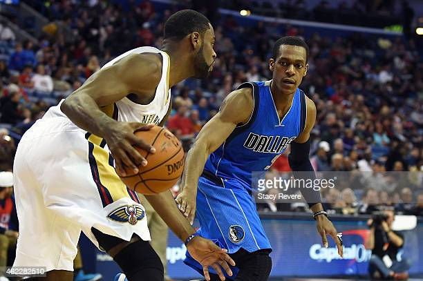 Tyreke Evans of the New Orleans Pelicans is defended by Rajon Rondo of the Dallas Mavericks during the second half of a game at the Smoothie King...