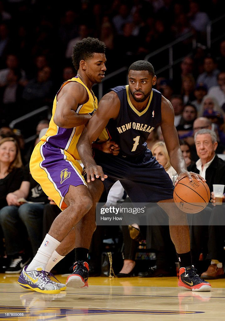 Tyreke Evans #1 of the New Orleans Pelicans is guarded by Nick Young #0 of the Los Angeles Lakers at Staples Center on November 12, 2013 in Los Angeles, California.