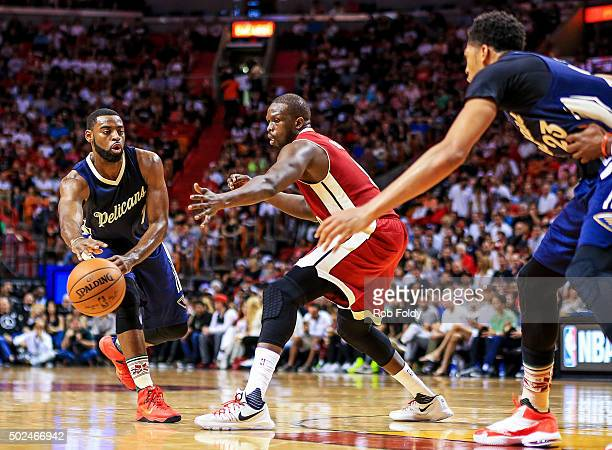 Tyreke Evans of the New Orleans Pelicans passes around Luol Deng of the Miami Heat to Anthony Davis during the game at American Airlines Arena on...