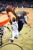 Tyreke Evans of the New Orleans Pelicans shoots against Michael KiddGilchrist of the Charlotte Bobcats on November 2 2013 at the New Orleans Arena in...