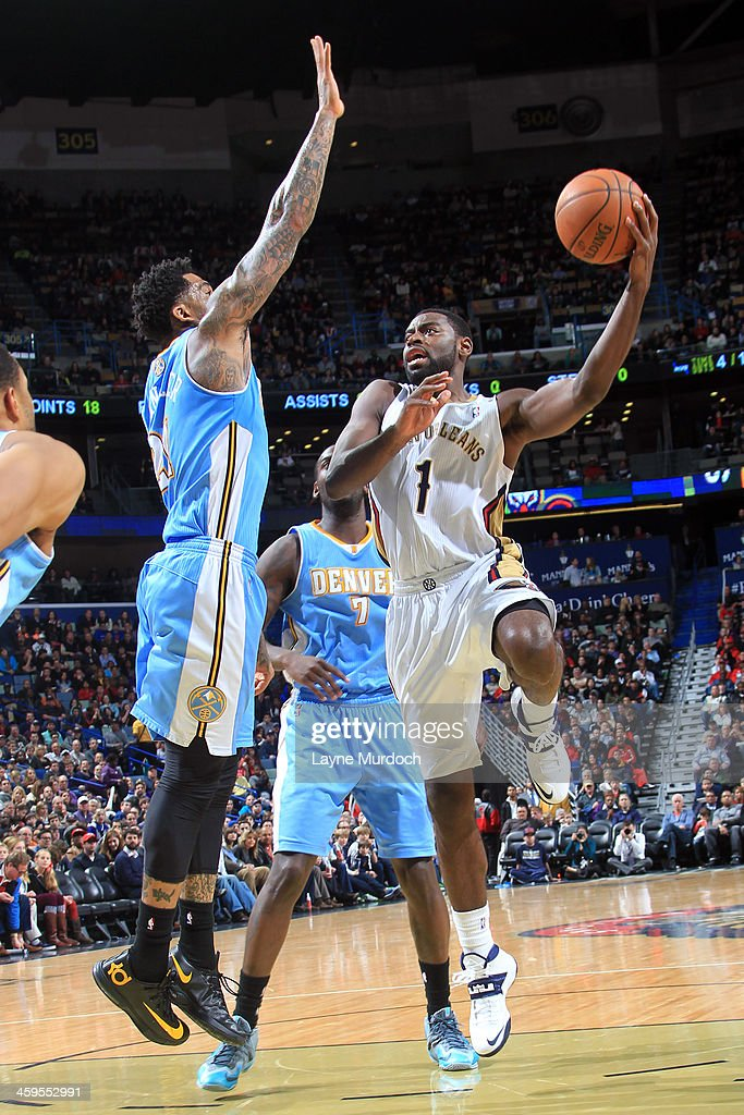 <a gi-track='captionPersonalityLinkClicked' href=/galleries/search?phrase=Tyreke+Evans&family=editorial&specificpeople=4851025 ng-click='$event.stopPropagation()'>Tyreke Evans</a> #1 of the New Orleans Pelicans shoots against the Denver Nuggets on December 27, 2013 at the New Orleans Arena in New Orleans, Louisiana.
