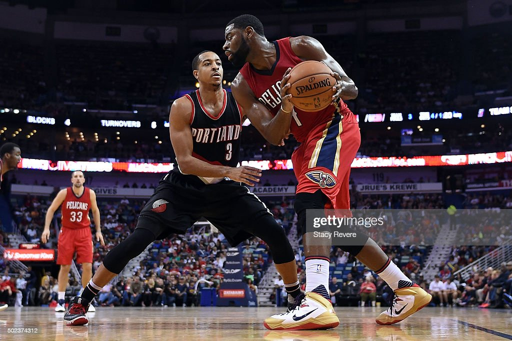 Tyreke Evans of the New Orleans Pelicans works against CJ McCollum of the Portland Trail Blazers during the first half of a game at the Smoothie King...
