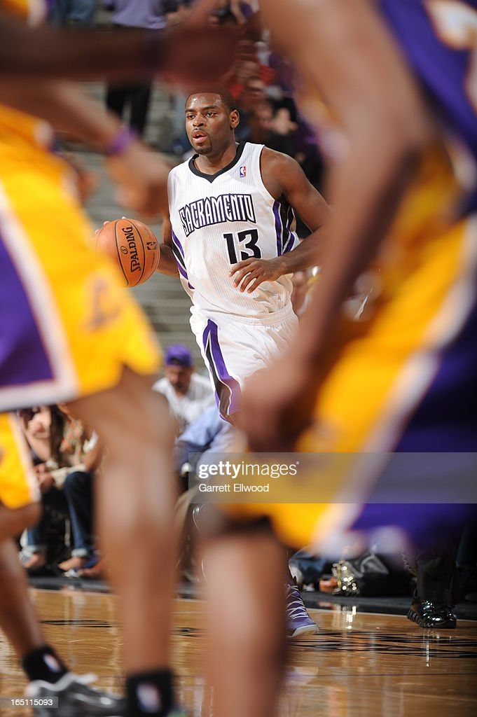 Tyreke Evans #13 of the Sacramento Kings dribbles the ball up the court against the Los Angeles Lakers on March 30, 2013 at Sleep Train Arena in Sacramento, California.