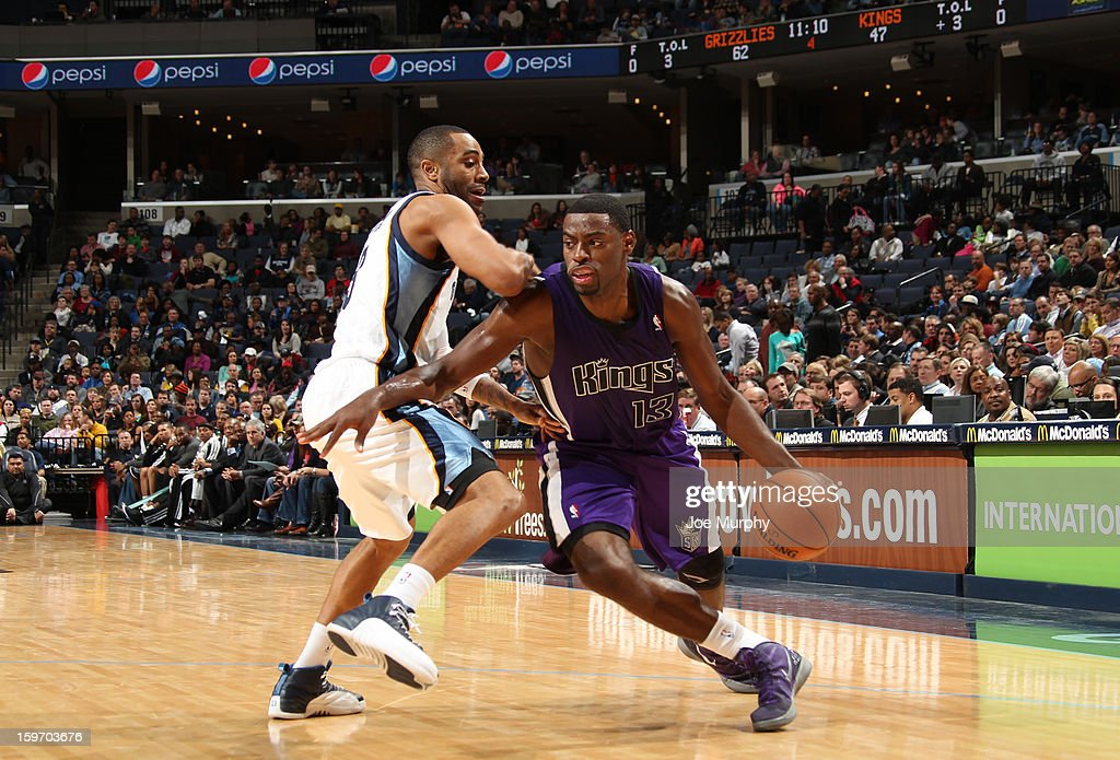 <a gi-track='captionPersonalityLinkClicked' href=/galleries/search?phrase=Tyreke+Evans&family=editorial&specificpeople=4851025 ng-click='$event.stopPropagation()'>Tyreke Evans</a> #13 of the Sacramento Kings drives against <a gi-track='captionPersonalityLinkClicked' href=/galleries/search?phrase=Wayne+Ellington&family=editorial&specificpeople=2351537 ng-click='$event.stopPropagation()'>Wayne Ellington</a> #3 of the Memphis Grizzlies on January 18, 2013 at FedExForum in Memphis, Tennessee.