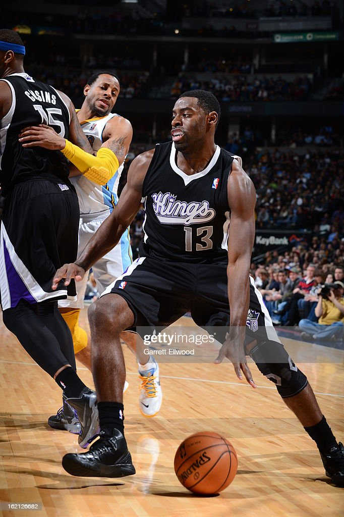 <a gi-track='captionPersonalityLinkClicked' href=/galleries/search?phrase=Tyreke+Evans&family=editorial&specificpeople=4851025 ng-click='$event.stopPropagation()'>Tyreke Evans</a> #13 of the Sacramento Kings drives baseline against the Denver Nuggets on January 26, 2013 at the Pepsi Center in Denver, Colorado.