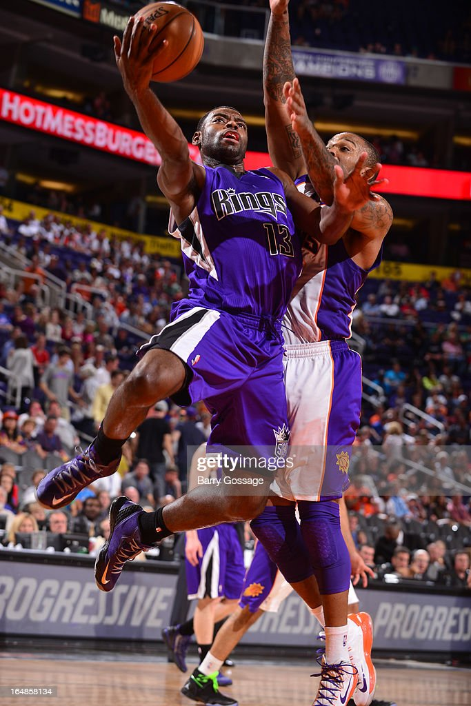 <a gi-track='captionPersonalityLinkClicked' href=/galleries/search?phrase=Tyreke+Evans&family=editorial&specificpeople=4851025 ng-click='$event.stopPropagation()'>Tyreke Evans</a> #13 of the Sacramento Kings drives for a shot against <a gi-track='captionPersonalityLinkClicked' href=/galleries/search?phrase=P.J.+Tucker&family=editorial&specificpeople=227316 ng-click='$event.stopPropagation()'>P.J. Tucker</a> #17 of the Phoenix Suns on March 28, 2013 at U.S. Airways Center in Phoenix, Arizona.