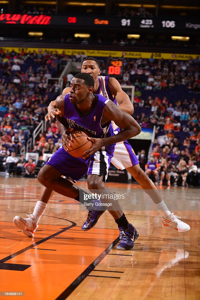 Tyreke Evans #13 of the Sacramento Kings drives for a shot past Wesley Johnson #2 of the Phoenix Suns on March 28, 2013 at U.S. Airways Center in Phoenix, Arizona.