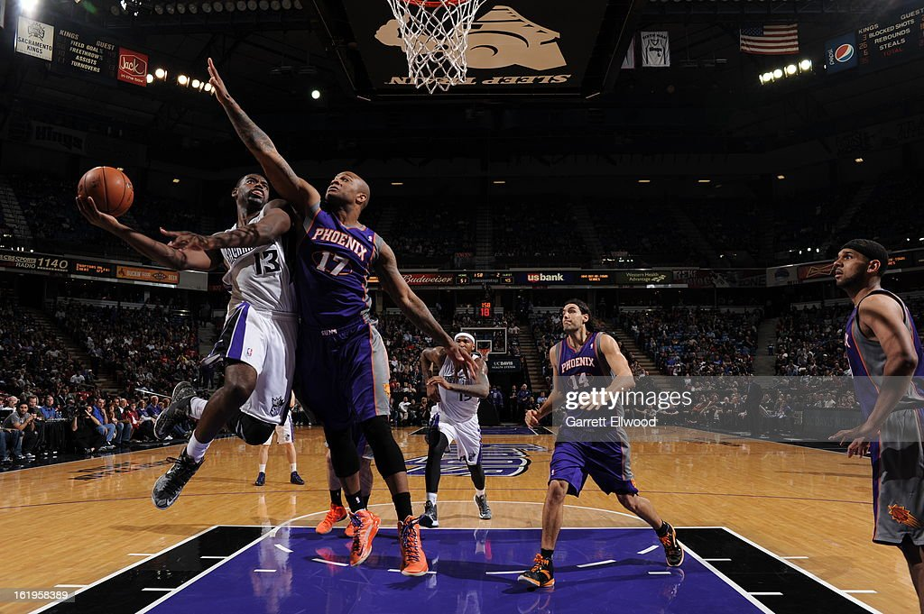 <a gi-track='captionPersonalityLinkClicked' href=/galleries/search?phrase=Tyreke+Evans&family=editorial&specificpeople=4851025 ng-click='$event.stopPropagation()'>Tyreke Evans</a> #13 of the Sacramento Kings drives to the basket against the Phoenix Suns on January 23, 2013 at Sleep Train Arena in Sacramento, California.