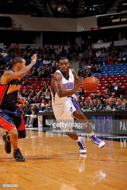 Tyreke Evans of the Sacramento Kings drives to the basket around Monta Ellis of the Golden State Warriors on November 8 2009 at ARCO Arena in...