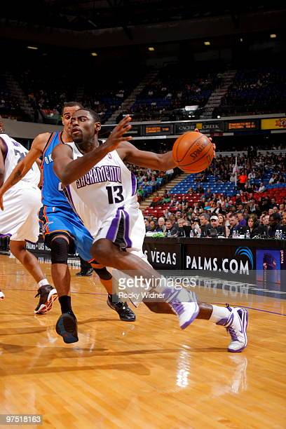 Tyreke Evans of the Sacramento Kings drives to the basket past Thabo Sefolosha of the Oklahoma City Thunder on March 7 2010 at ARCO Arena in...