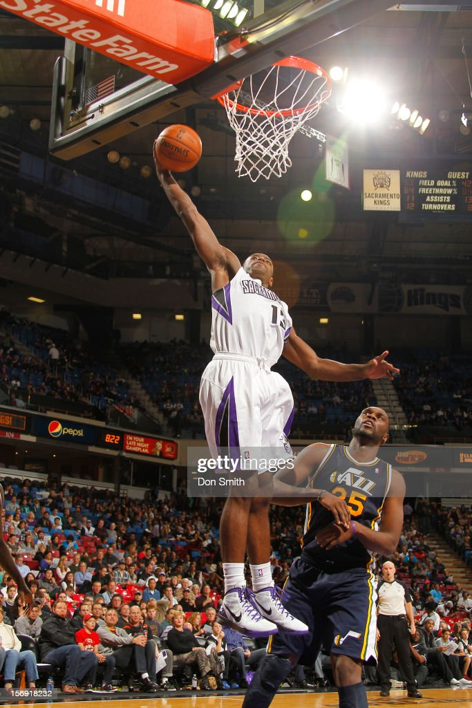 <a gi-track='captionPersonalityLinkClicked' href=/galleries/search?phrase=Tyreke+Evans&family=editorial&specificpeople=4851025 ng-click='$event.stopPropagation()'>Tyreke Evans</a> #13 of the Sacramento Kings dunks the ball against <a gi-track='captionPersonalityLinkClicked' href=/galleries/search?phrase=Al+Jefferson&family=editorial&specificpeople=201604 ng-click='$event.stopPropagation()'>Al Jefferson</a> #25 of the Utah Jazz on November 24, 2012 at Sleep Train Arena in Sacramento, California.