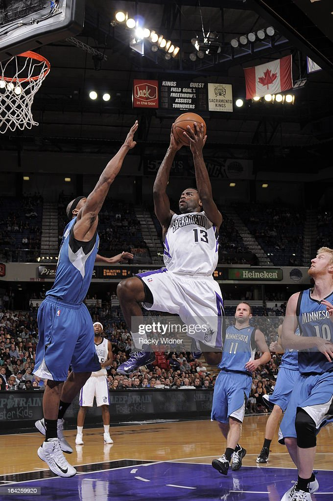 Tyreke Evans #13 of the Sacramento Kings goes to the basket against Dante Cunningham #33 of the Minnesota Timberwolves on March 21, 2013 at Sleep Train Arena in Sacramento, California.