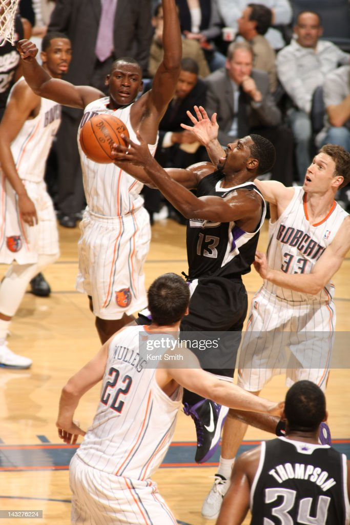 <a gi-track='captionPersonalityLinkClicked' href=/galleries/search?phrase=Tyreke+Evans&family=editorial&specificpeople=4851025 ng-click='$event.stopPropagation()'>Tyreke Evans</a> #13 of the Sacramento Kings goes to the basket against <a gi-track='captionPersonalityLinkClicked' href=/galleries/search?phrase=Matt+Carroll+-+Basketspelare&family=editorial&specificpeople=213200 ng-click='$event.stopPropagation()'>Matt Carroll</a> #33, <a gi-track='captionPersonalityLinkClicked' href=/galleries/search?phrase=Bismack+Biyombo&family=editorial&specificpeople=7640443 ng-click='$event.stopPropagation()'>Bismack Biyombo</a> #0 and Byron Mullens #22 of the Charlotte Bobcats at the Time Warner Cable Arena on April 22, 2012 in Charlotte, North Carolina.