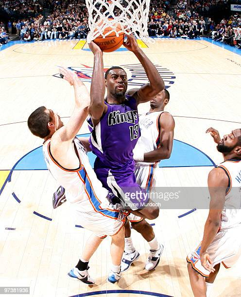 Tyreke Evans of the Sacramento Kings goes to the basket against Nick Collison of the Oklahoma City Thunder on March 2 2010 at the Ford Center in...